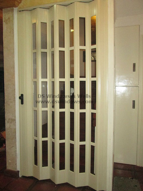 Full glass french type folding door as staircase door las for Full glass french doors
