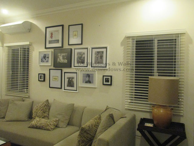 Wooden blinds for monochromatic living room interior for Living room interior design philippines