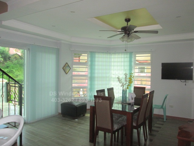 Fabric blinds townhouse dining area